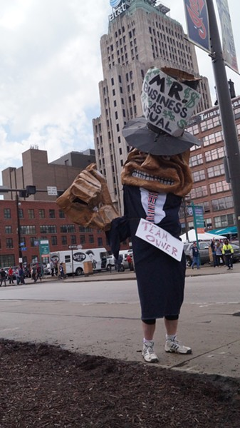 """""""Mr. Business as Usual,"""" a CAST puppet outside Progressive Field at the Cleveland Indians' home opener. - SAM ALLARD / SCENE"""