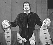 Steve Tague (center, with Rosencrantz and - Guildenstern) makes an appropriately gaunt Hamlet.