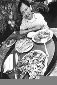 Strokes of Loc: Tay Do owner Loc Nguyen, with a few of his restaurant's - stars. - WALTER  NOVAK