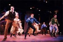 The brothers, suitors, and town girls dance out their differences.