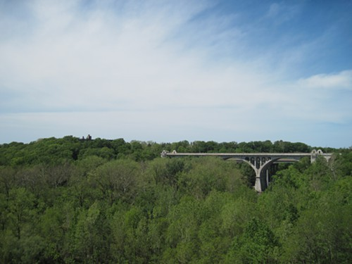 The Hilliard Road bridge looms in the distance.