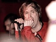 The (International) Noise Conspiracy's Dennis Lyxzn, at the Grog Shop December 18. - WALTER  NOVAK