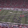 The Ohio State University Marching Band Transformed into a Prowling T-Rex and Ate Someone