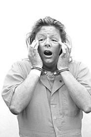 The real Aileen Wuornos, freaky lack of eyebrows and - all, strikes a scary pose.