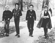 The Sex Pistols unwind with a stroll in the park.