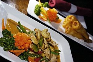 The String Bean: Crunchy cashews top tender-crisp vegetables and sautéed chicken. - WALTER NOVAK