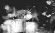 The Tight Bros. gather 'round their rubber drummer.