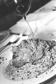 The veal osso buco, atop a mound of red-pepper - risotto, was a long-simmered delight. - WALTER  NOVAK