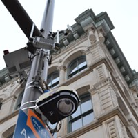 "Pictures For ""A Traffic Ticket and a Bullet Through the Chest"" This surveillance camera on the corner of St. Clair and West Sixth caught the action below"