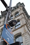This surveillance camera on the corner of St. Clair and West Sixth caught the action below