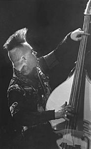 Tiger Army bassist Rob Peltier, doing his thing at the - Agora on November 22. - WALTER  NOVAK