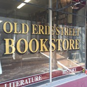 Movers Actively Clearing out Old Erie Street Bookstore Downtown