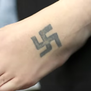 Video: The Ohio Tattoo Artist Covering Up Swastikas and Other Racist Tattoos for Free
