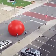 VIDEO: 250-Pound Red Ball Art Installation Goes Rogue, Rolls Through Toledo Streets