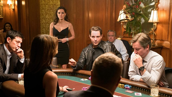 Jessica Chastain (standing) in Molly's Game