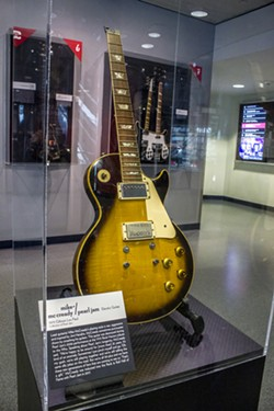 Mike McCready's busted-up guitar. - COURTESY OF THE ROCK HALL