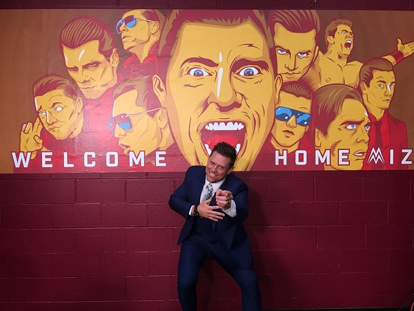 The Miz, before a mural by local artist OKPants. - INSTAGRAM: @MIKETHEMIZ