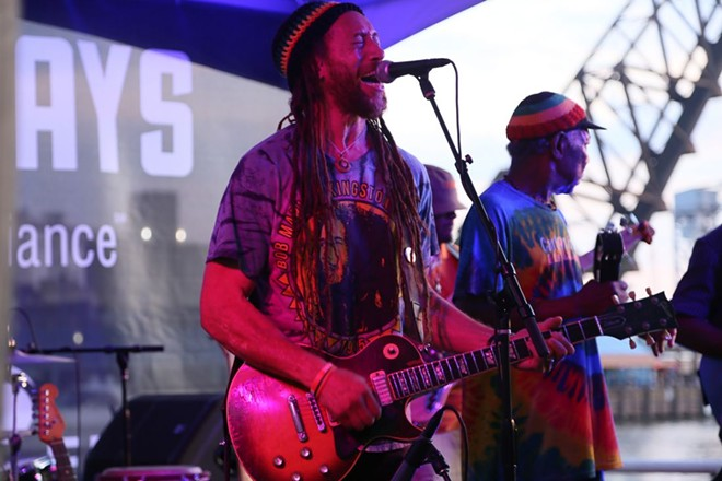 Carlos Jones and the PLUS Band performing at Flat Out Fridays at the East Bank of the Flats last August. - EMANUEL WALLACE PHOTOS
