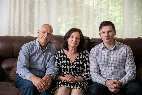 Rustem Kazazi, left, sits at home with wife, Lejla, and son Erald in Parma Heights, Ohio. - COURTESY OF INSTITUTE FOR JUSTICE