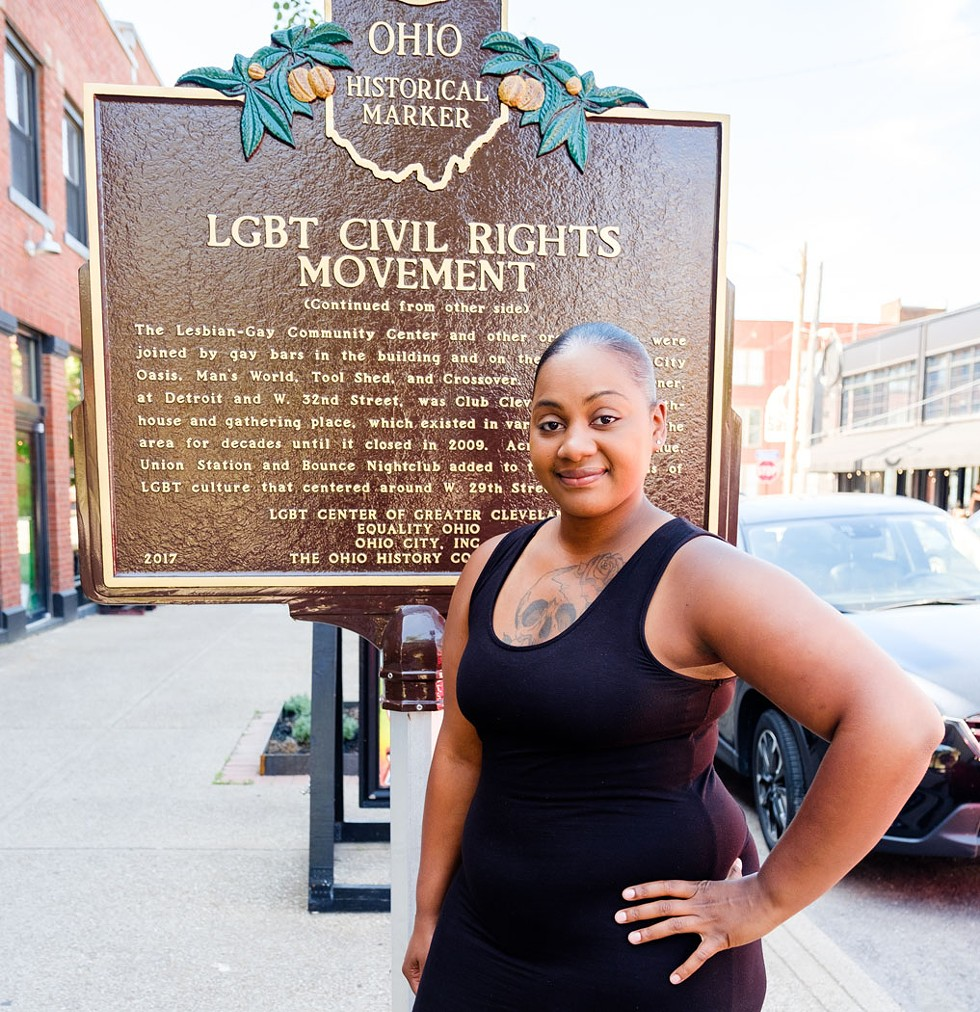 Sonia Emerson stands before the Ohio City LGBT historical marker. - PHOTO BY YOSHI ANDREGOLO, SPLIT CREATIVE