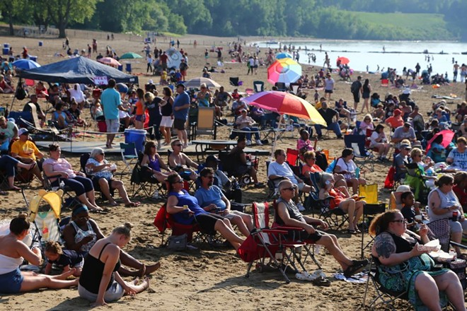 Crowds gather at Edgewater Beach last summer. - PHOTO BY EMANUEL WALLACE