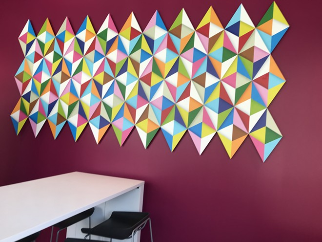 "This first-floor lounge area features the piece ""53 Rhombuses"" by Cleveland artist Andrew Reach."