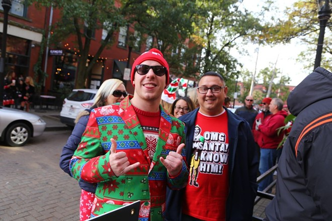 Market Avenue can be seen behind Great Lakes Brewing Company Christmas Ale revelers. - PHOTO BY EMANUEL WALLACE