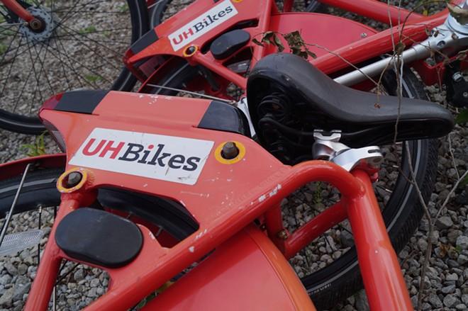 The UH Bikes graveyard across from Rivergate Park, (7/30/19). - SAM ALLARD / SCENE