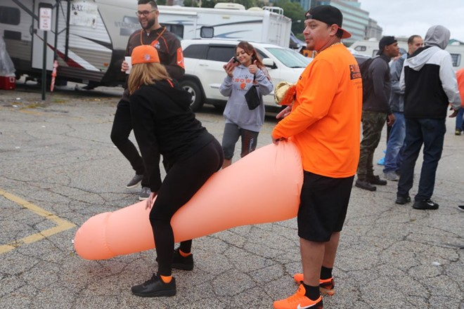 The Browns vs. Steelers game was the No. 1 trending topic on Google this year in Ohio. This photo shows Browns fans gearing up in the Muni Lot  for a game against the Steelers back in 2018. - PHOTO BY EMANUEL WALLACE