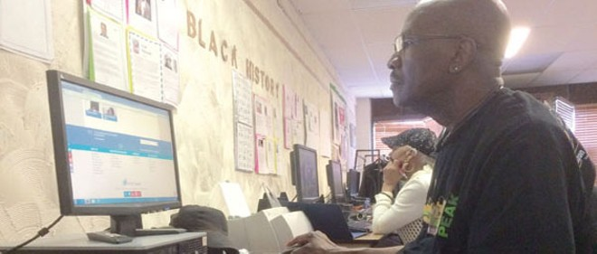 Howard Barksdale, 66, works through a class at Ashbury Senior Computer Community Center. - ERIC SANDY
