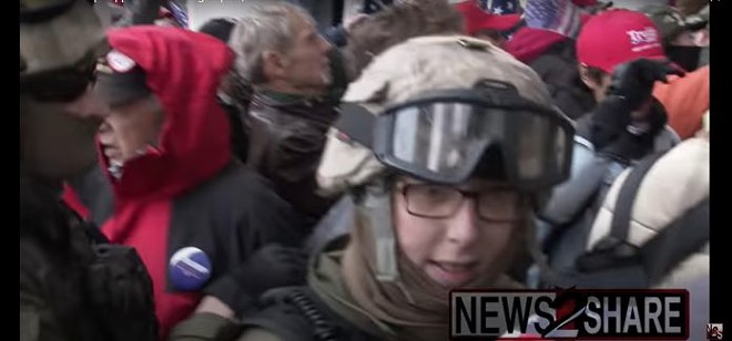 A still from footage of the riots in Washington D.C. captures Jessica Watkins, 38, seen with several people in Oathkeepers regalia, heading up the Capitol stairs. Screenshot from YouTube, credit Ford Fischer / News2Share.