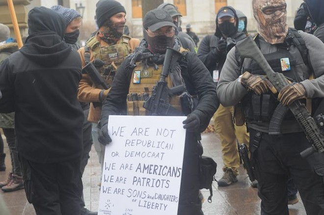 Armed men identifying themselves with the Boogaloo Movement stand outside the Ohio Capitol Jan. 17. Photo by Jake Zuckerman/OCJ. - OHIO CAPITAL JOURNAL