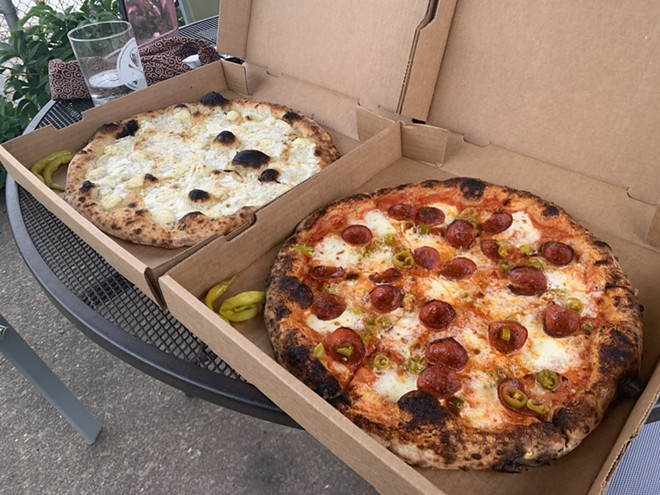 A pair of pies from Cent's Pizza in Ohio City. - MATTHEW T