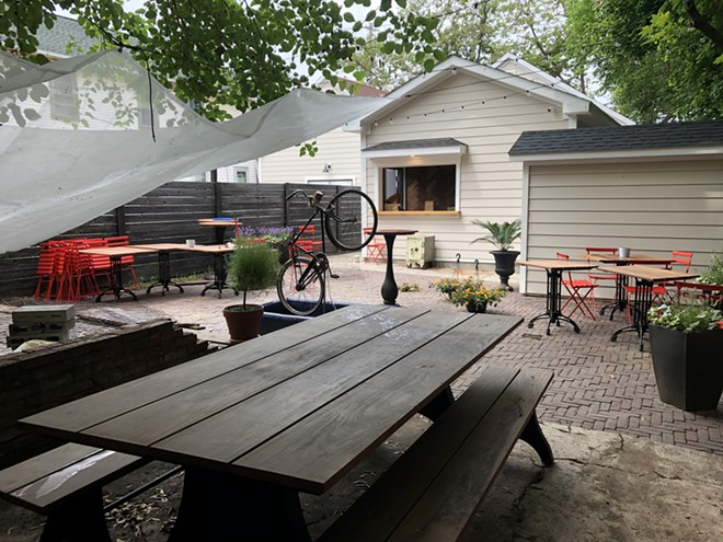 Il Rione's new back patio and bar provides diners waiting for a table with a place to hang. - BRIAN HOLLERAN