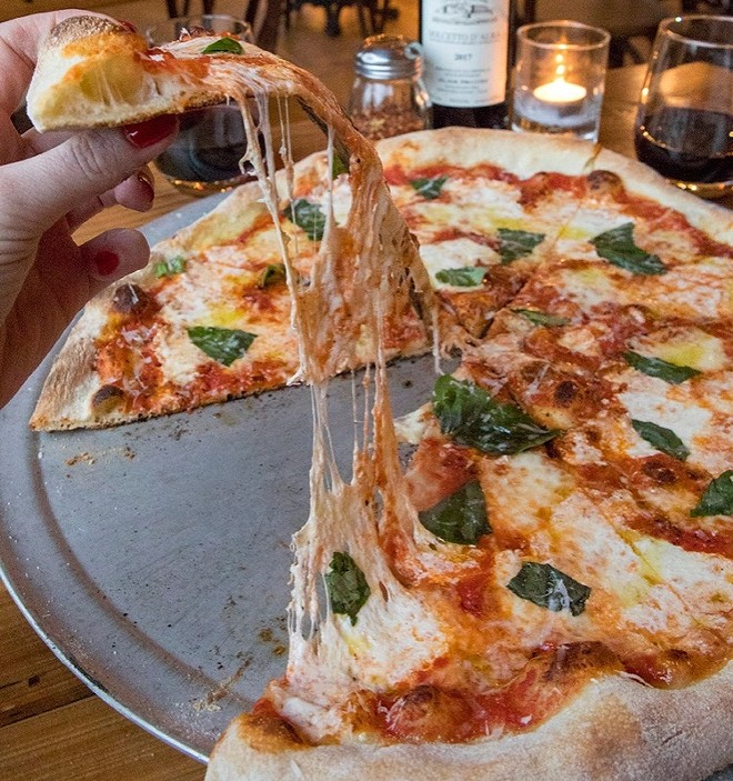 The pizza is only one of the main draws at Il Rione. - MOLLY GEIB