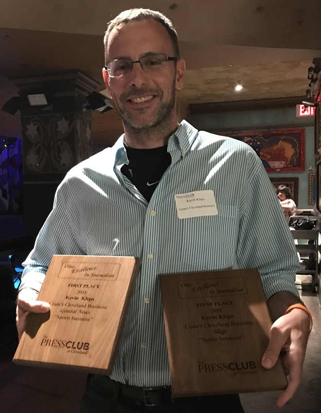Kleps flashes his hardware, after taking home top honors in the 2018 All Ohio Excellence in Journalism Awards. - COURTESY KEVIN KLEPS