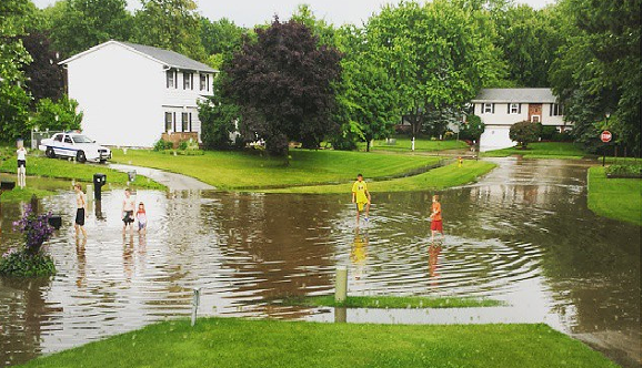 A suburban cul-de-sac turns into a water park. - COURTESY OF INSTAGRAM USER @STEELEYSUZY