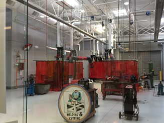 The high school has 11 large workshop bays that will zero in on particular trades, like welding. - ERIC SANDY / SCENE