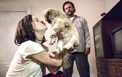 Taryn Manning as Michelle Knight and Raymond Cruz as Ariel Castro. - LIFETIME