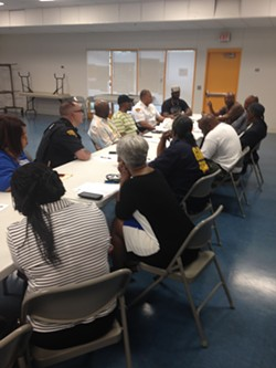 Reggie Rucker and Community Members, talking violence interruption pre-Brelo at the Zelma George Community Center - SAM ALLARD / SCENE