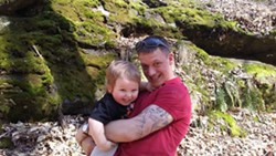 RJ and his son - COURTESY OF CAMELIA CARTER