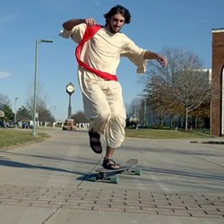 Joe Gerin likes to longboard around the University of Akron dressed as Jesus. - INSTAGRAM