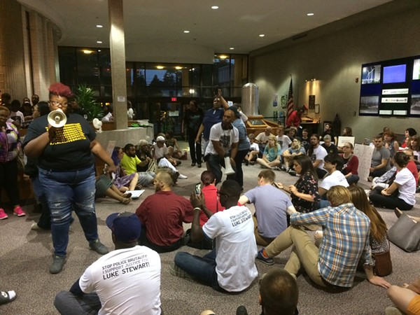 Rian Brown speaks to protesters in the lobby of the Euclid Municipal Building.