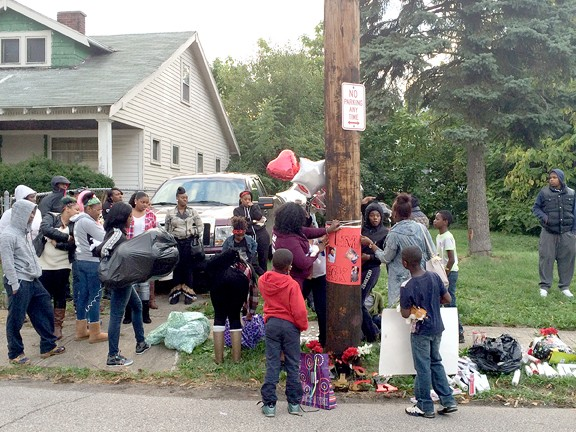 """Friends and family members of Dexter """"Deck"""" Mangham begin constructing his memorial site on East 113th Street in 2015. This is where the Sunday shooting took place. - ERIC SANDY / SCENE"""