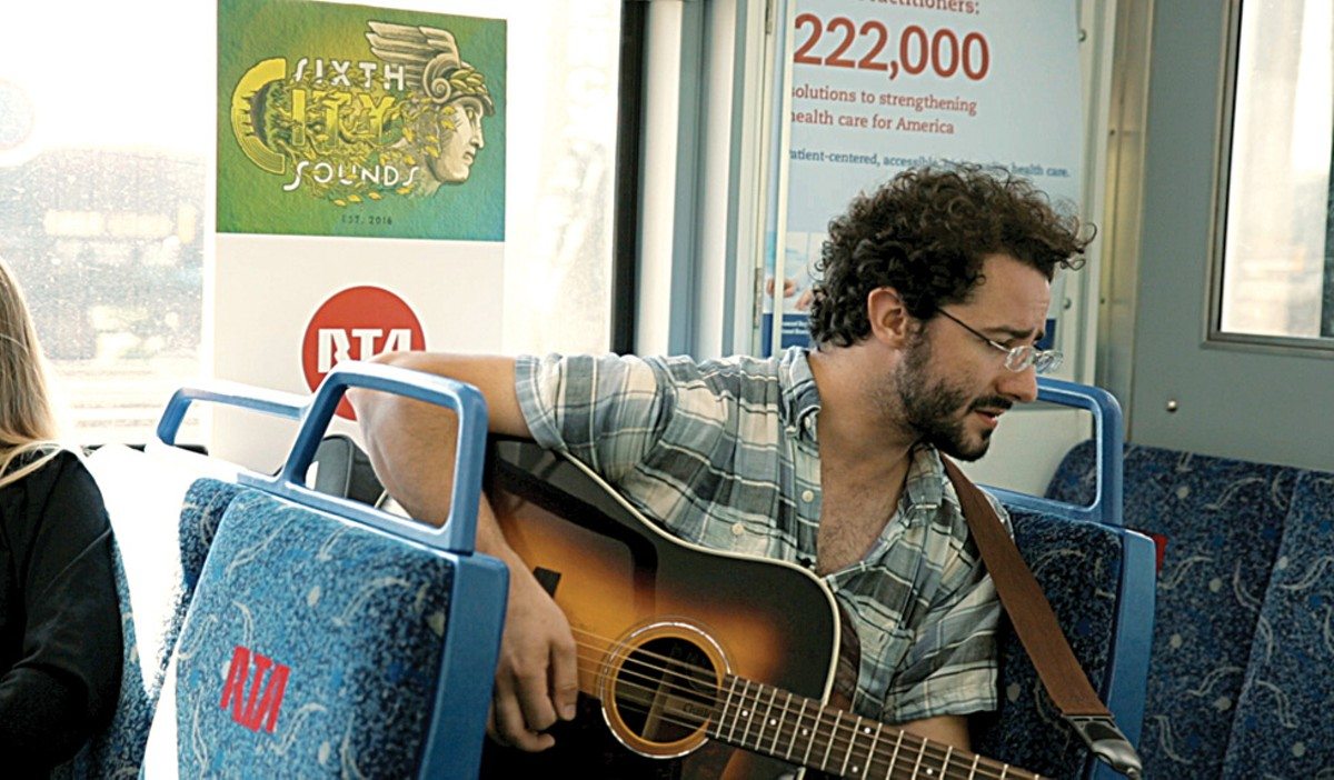 Ray Flanagan performs on an RTA train earlier this summer.