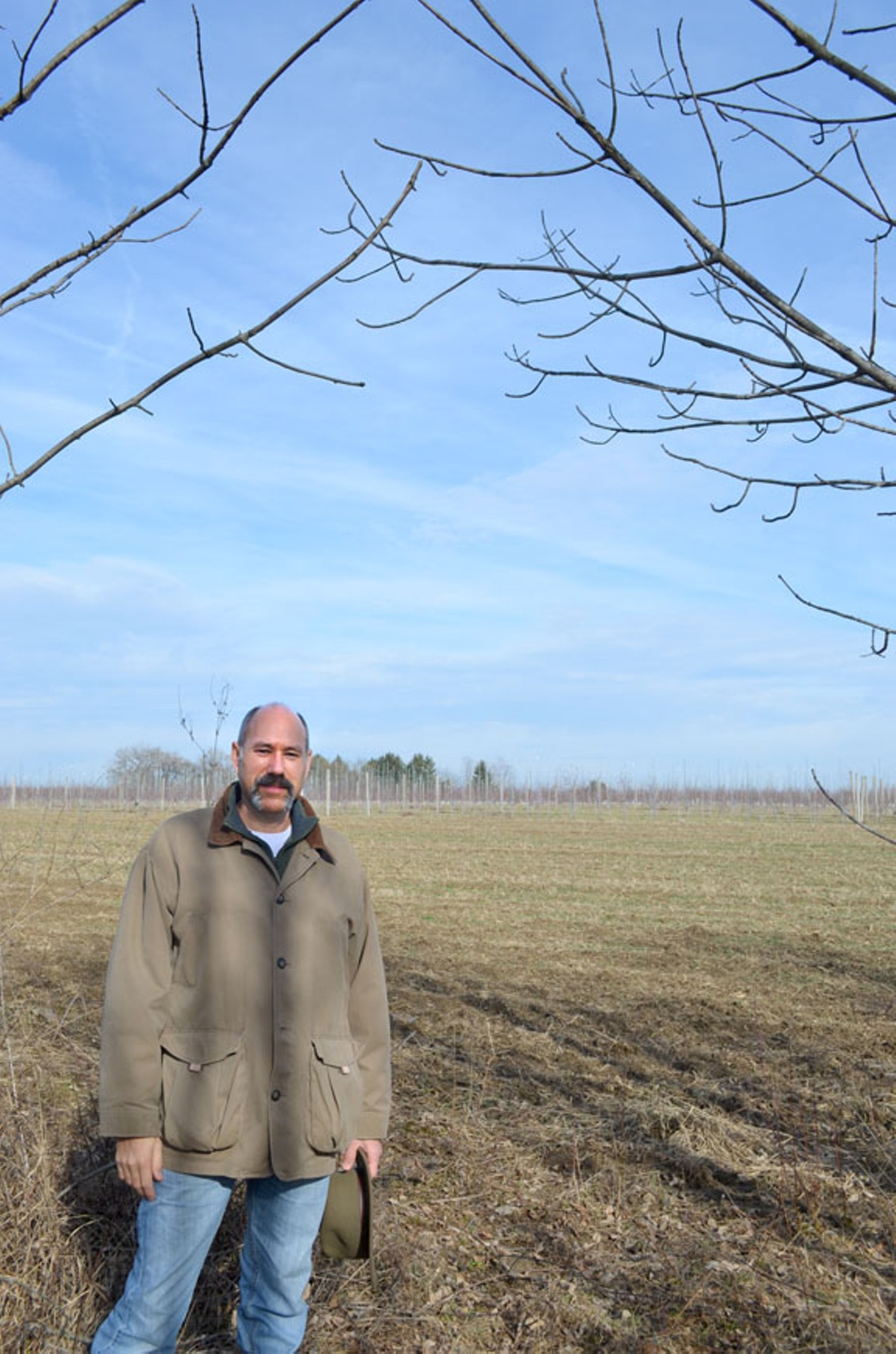Jon Strong stands in the middle of the proposed Nexus route on his property in Guilford Township, Ohio.