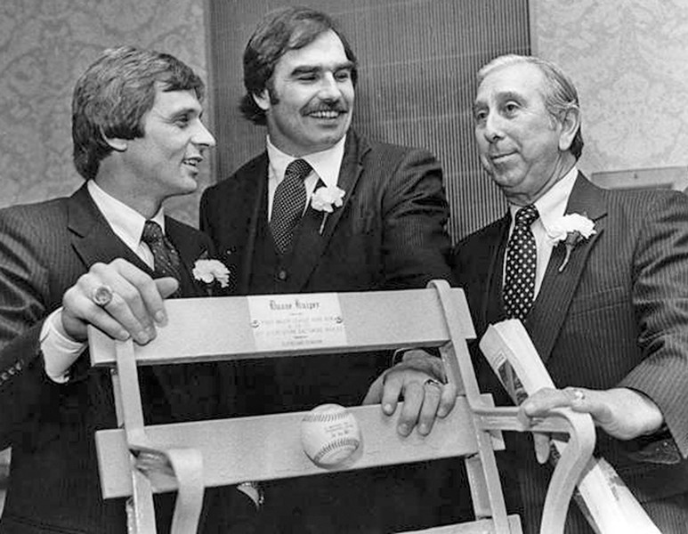 Duane Kuiper, left, Doug Dieken, and Tribe manager Dave Garcia, right, stand by the stadium - seat presented to Kulper in honor of his only Major-League home run. - PHOTO COURTESY OF CLEVELAND MEMORY PROJECT