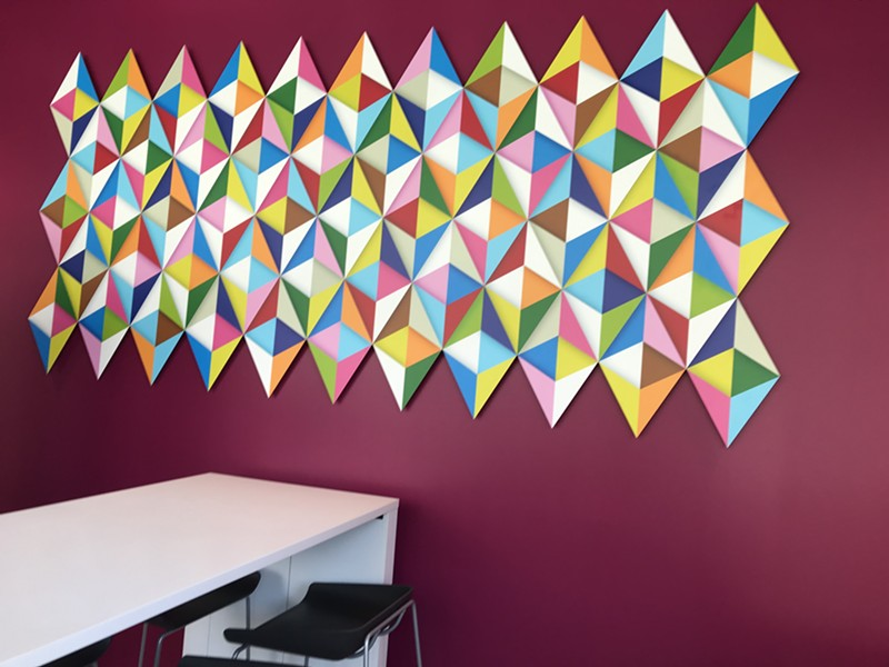 """This first-floor lounge area features the piece """"53 Rhombuses"""" by Cleveland artist Andrew Reach."""