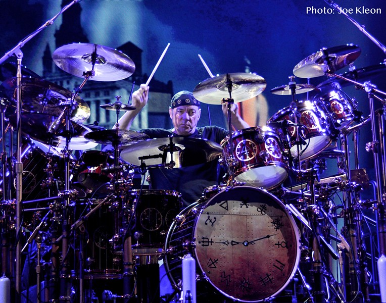 Neil Peart performing with Rush in 2012 at Quicken Loans Arena. - JOE KLEON