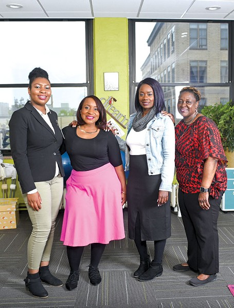 Christin Farmer (Second from right) and part of her team. - PHOTO BY TIM HARRISON